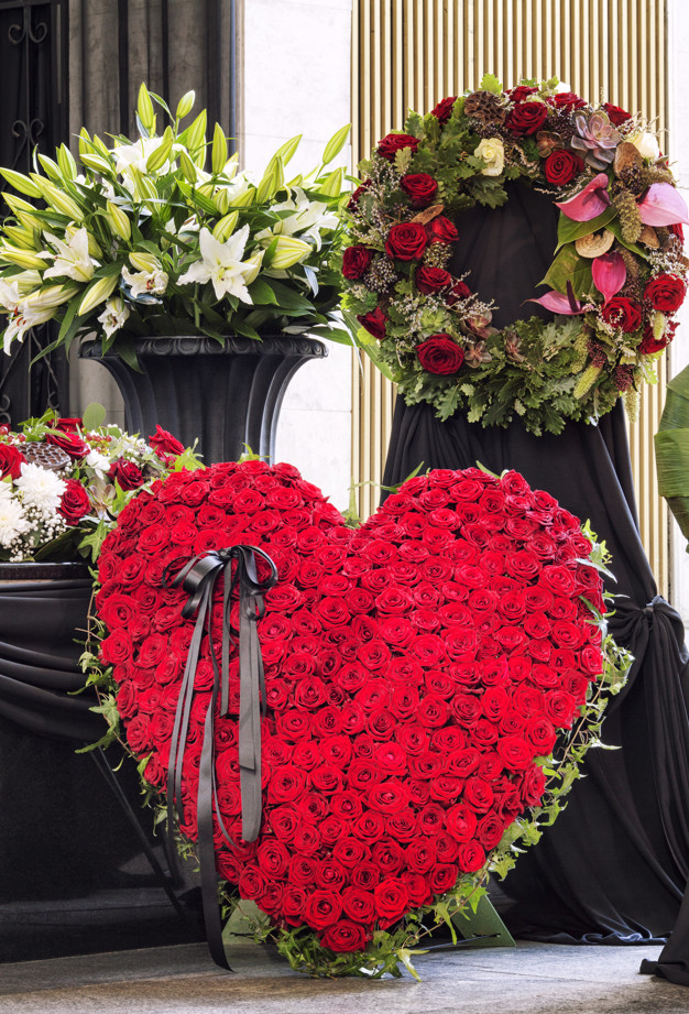 Funeral, beautifully decorated with flower arrangements coffin,